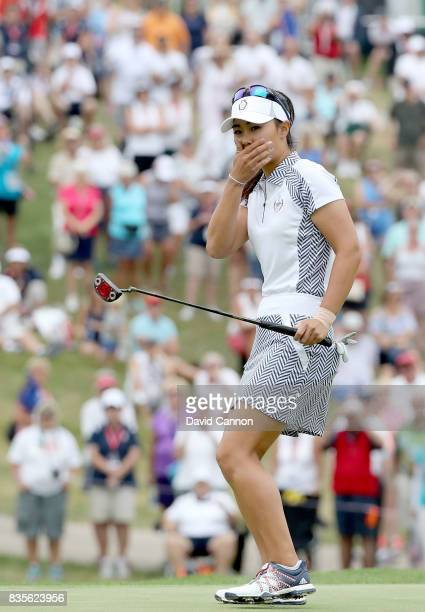 Danielle Kang of the United States Team reacts as her putt on the 15th hole just misses in her match with Michelle Wie against Catriona Matthew and...