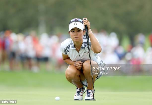Danielle Kang of the United States Team rlines up a putt on the 17th hole in her match with Michelle Wie against Catriona Matthew and Karine Icher of...