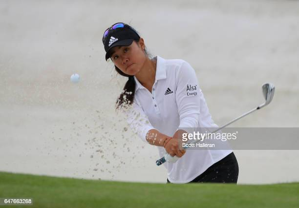 Danielle Kang of the USA hits a bunker shot on the first hole during the third round of the HSBC Women's Champions on the Tanjong Course at Sentosa...