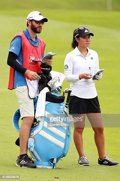 Danielle Kang of United States and her caddie on the 16th hole during day one of the Sime Darby LPGA at TPC Kuala Lumpur on October 27 2016 in Kuala...