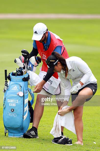 Danielle Kang of United States cleans her foot on the 16th hole during day one of the Sime Darby LPGA at TPC Kuala Lumpur on October 27 2016 in Kuala...