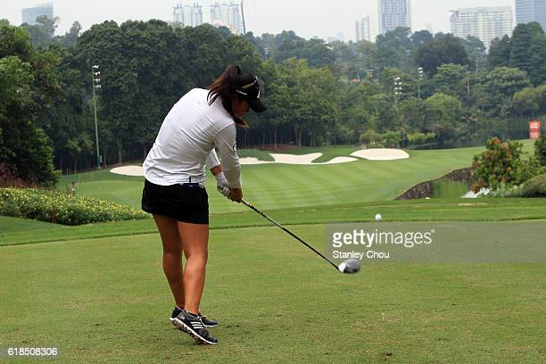 Danielle Kang of United States plays a tee shot on the 16th hole during day one of the Sime Darby LPGA at TPC Kuala Lumpur on October 27 2016 in...