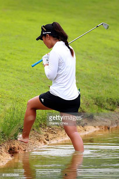 Danielle Kang of United States prepares to play while her foot are inside the water on the 16th hole during day one of the Sime Darby LPGA at TPC...