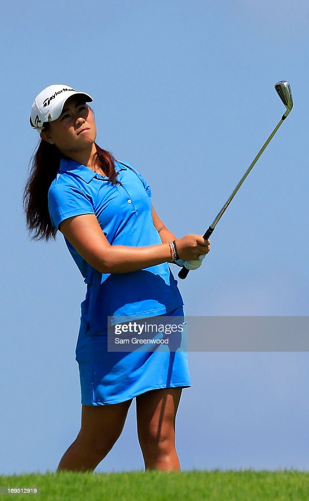 Danielle Kang plays a shot on the 12th hole during the second round of the Pure Silk-Bahamas LPGA Classic at the Ocean Club course on May 25, 2013 in Paradise Island, Bahamas.