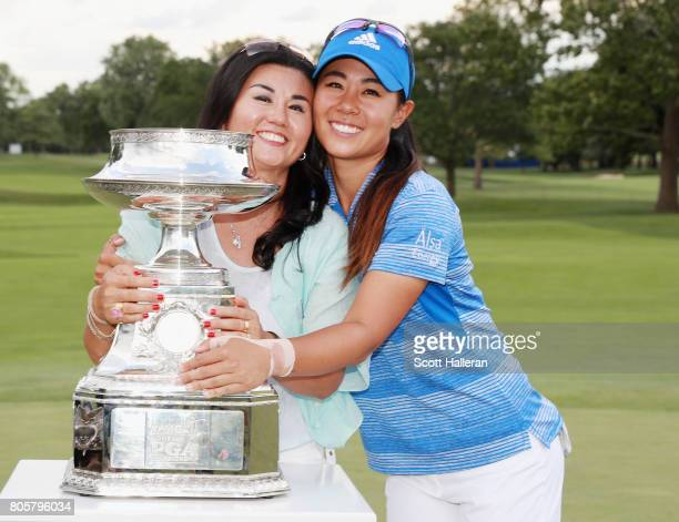 Danielle Kang poses her mother Grace Lee and the trophy after winning the 2017 KPMG Women's PGA Championship at Olympia Fields Country Club on July 2...