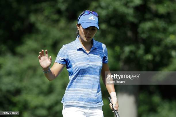 Danielle Kang reacts to a birdie putt on the 14th green during the final round of the 2017 KPMG PGA Championship on July 2 2017 in Olympia Fields...