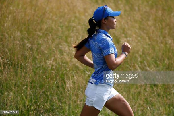 Danielle Kang runs down a hill while leaving the 15th tee during the final round of the 2017 KPMG PGA Championship at Olympia Fields Country Club on...