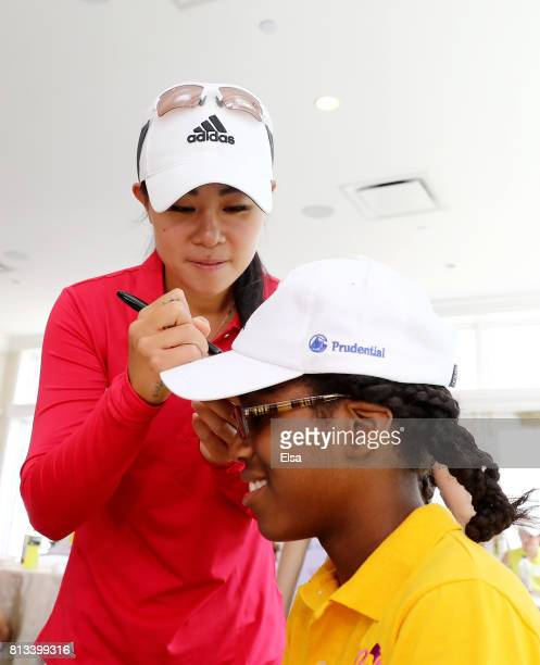 Danielle Kang signs autographs during Girls Golf VIP Experience by Prudential during the US Women's Open preview day 3 on July 12 2017 at Trump...