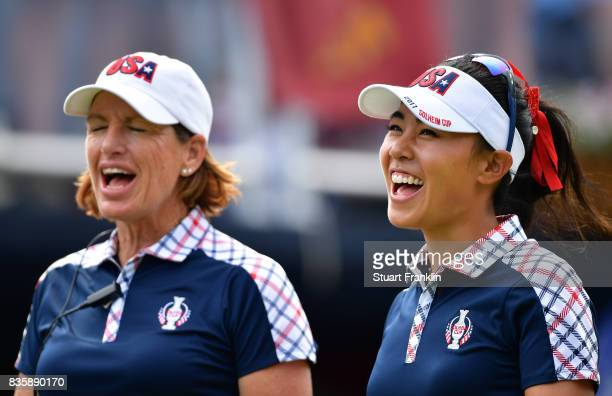 Danielle Kang sings with Juli Inkster Captain of Team USA during the final day singles matches of The Solheim Cup at Des Moines Golf and Country Club...