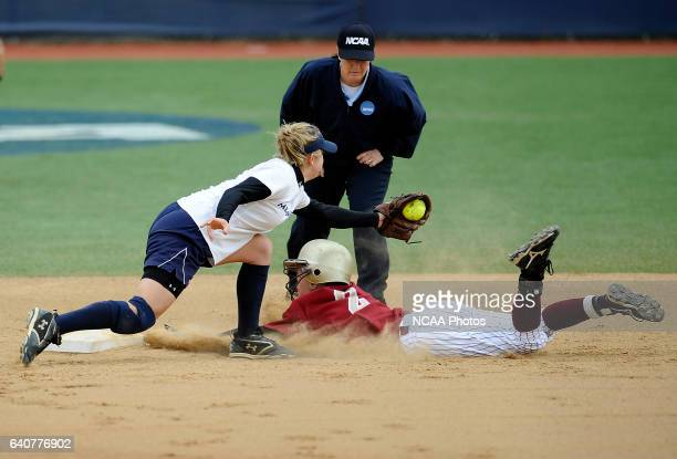 Danielle Leavens of Coe College is tagged out by Lauren Seneca of Messiah College during the Division III Women's Softball Championship held at the...