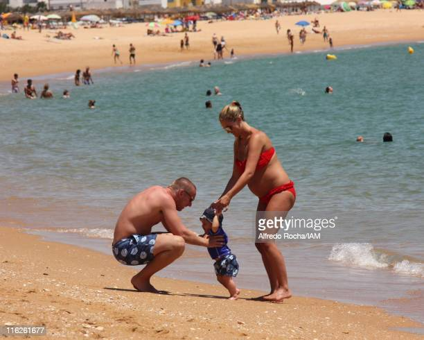 Danielle Lloyd and Jamie O'Hara with baby Archie sighted on holiday in Portugal on June 11 2011