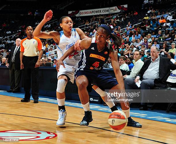 Danielle McCray of the Connecticut Sun drives against Armintie Price of the Atlanta Dream at Philips Arena on June 17 2012 in Atlanta Georgia NOTE TO...
