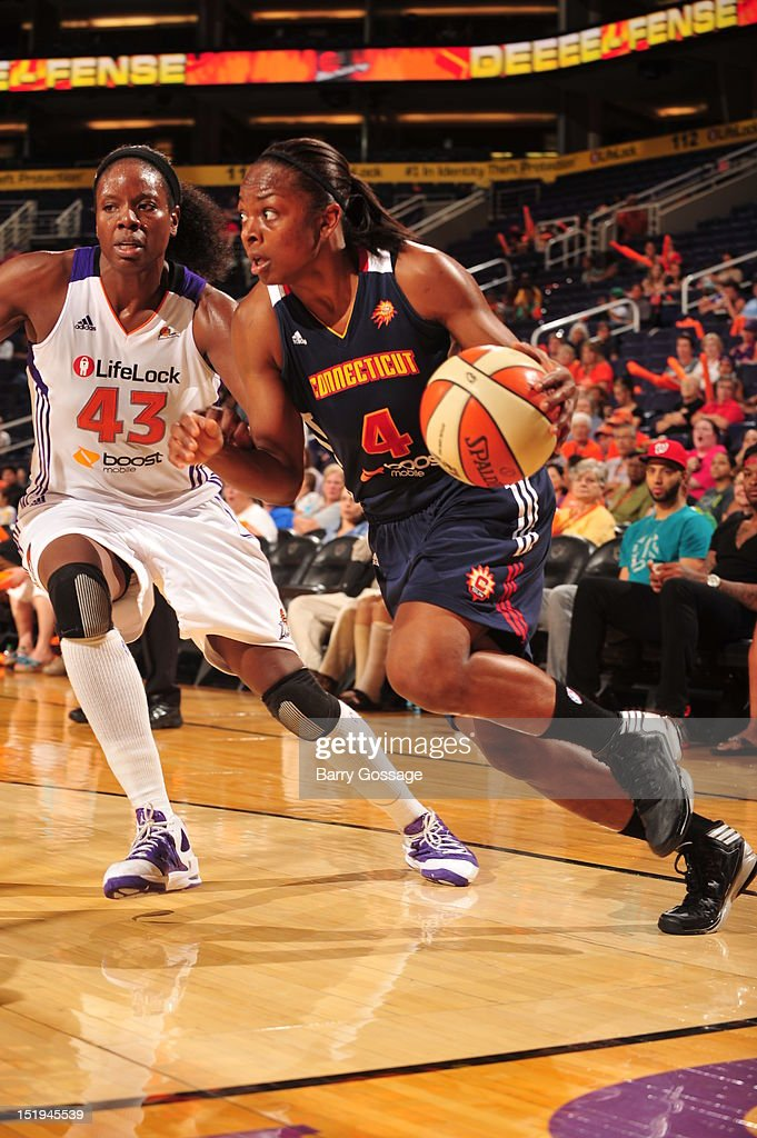 Danielle McCray of the Connecticut Sun drives against Nakia Sanford of the Phoenix Mercury on September 12 2012 at US Airways Center in Phoenix...
