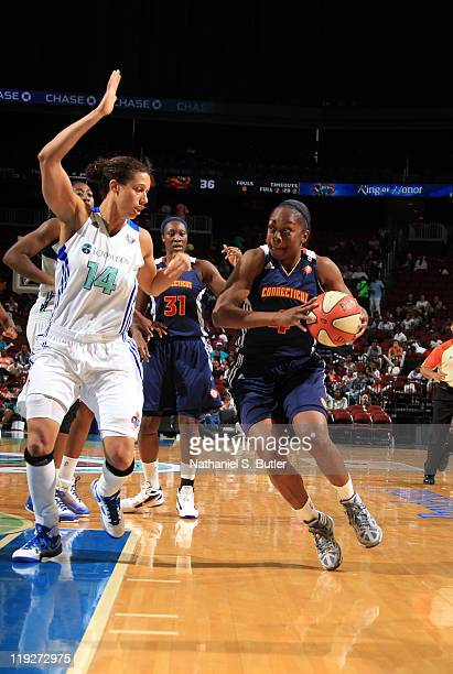 Danielle McCray of the Connecticut Sun goes up against Nicole Powell of the New York Liberty during a game on July 15 2011 at the Prudential Center...