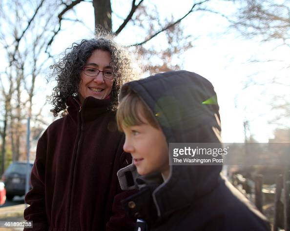 Danielle Meitiv waits with her son Rafi Meitiv for Danielle's daughter Dvora Meitiv to be dropped off at the neighborhood school bus stop in Silver...