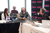 Danielle Monaro and Elvis Duran interview Pitbull during his visit to 'The Elvis Duran Z100 Morning Show' at One World Observatory on December 1 2015...