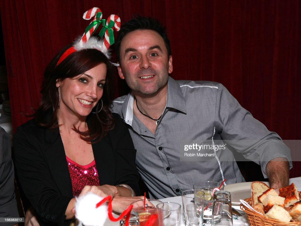 Danielle Monaro (L) and husband Sheldon attend Elvis Duran Morning Show Holiday Party at Carmine's on December 14, 2012 in New York City.