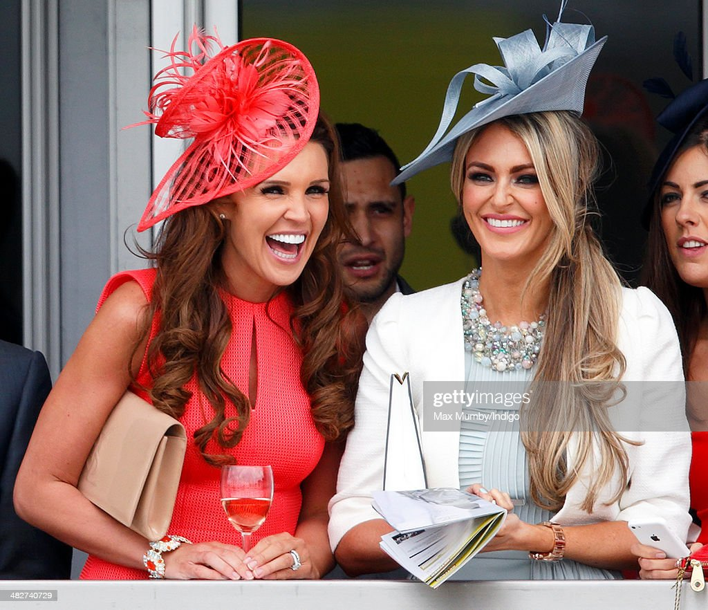 Danielle O'Hara and Georgina Dorsett watch the racing as they attend day 2, Ladies Day, of the Crabbie's Grand National horse racing meet at Aintree Racecourse on April 4, 2014 in Liverpool, England.