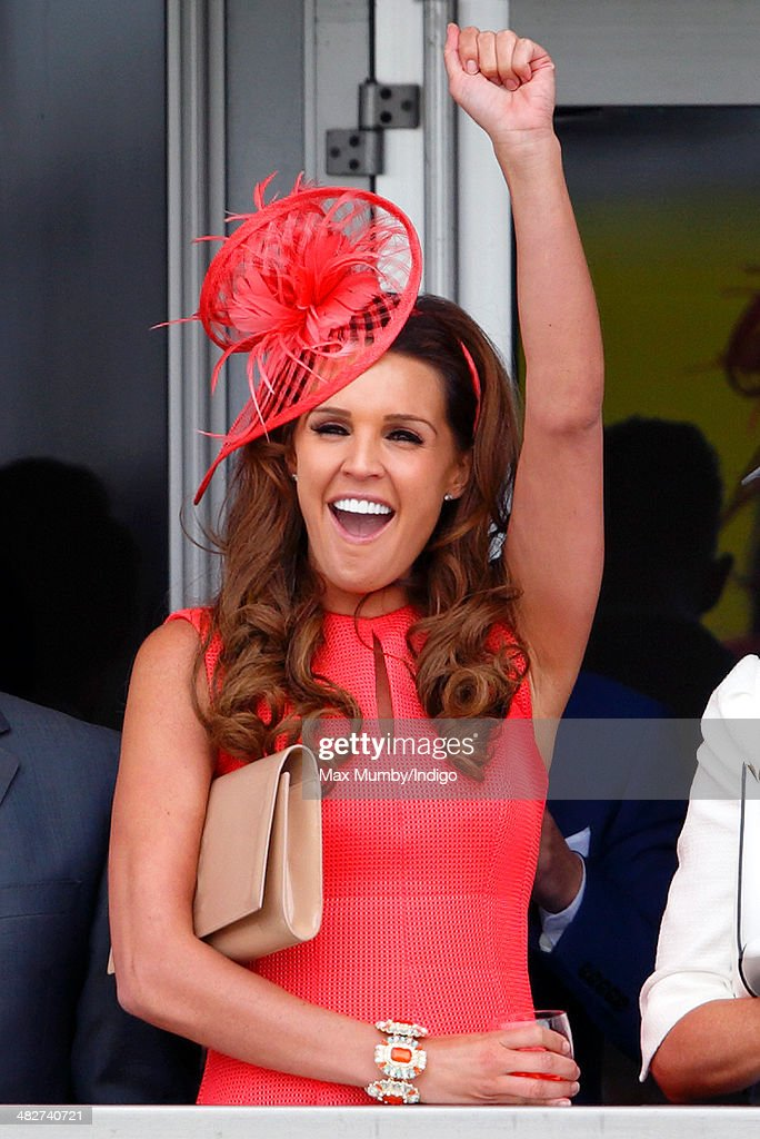 Danielle O'Hara watches the racing as she attends day 2, Ladies Day, of the Crabbie's Grand National horse racing meet at Aintree Racecourse on April 4, 2014 in Liverpool, England.