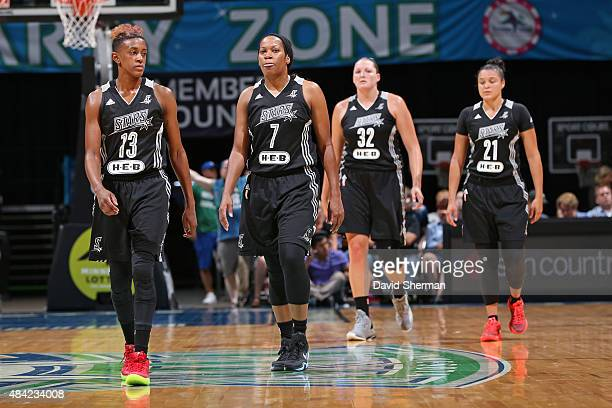 Danielle Robinson Jia Perkins Jayne Appel and Kayla McBride of the San Antonio Stars walk towards their bench during a game against the Minnesota...