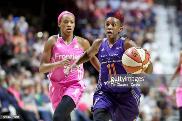 Danielle Robinson of the Phoenix Mercury defended by Jasmine Thomas of the Connecticut Sun during the Connecticut Sun Vs Phoenix Mercury WNBA regular...