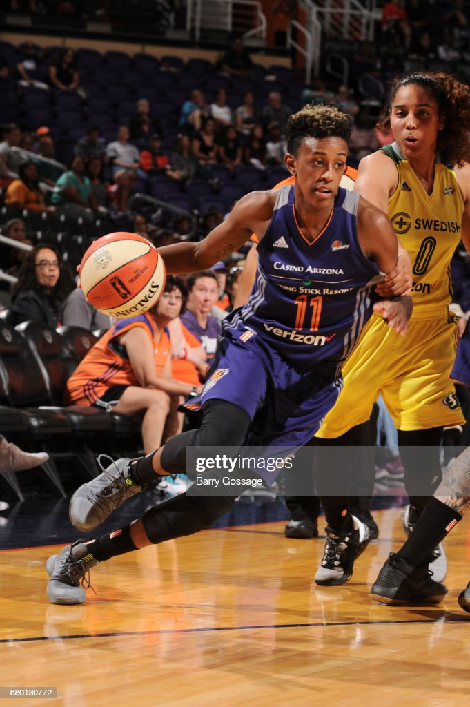 Danielle Robinson #11 of the Phoenix Mercury drives to the basket against the Seattle Storm during a preseason game on May 7, 2017 at Talking Stick Resort Arena in Phoenix, Arizona.