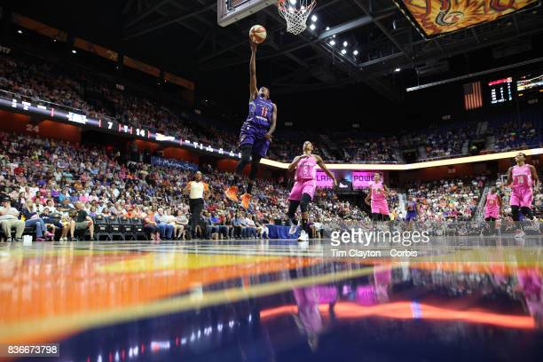 Danielle Robinson of the Phoenix Mercury drives to the basket defended by Jasmine Thomas of the Connecticut Sun during the Connecticut Sun Vs Phoenix...