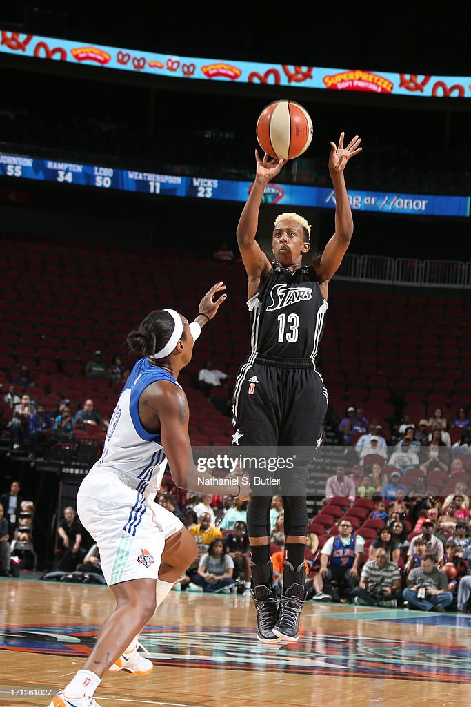 Danielle Robinson #13 of the San Antonio Silver Stars shoots against <a gi-track='captionPersonalityLinkClicked' href=/galleries/search?phrase=Cappie+Pondexter&family=editorial&specificpeople=544600 ng-click='$event.stopPropagation()'>Cappie Pondexter</a> #23 of the New York Liberty during a game on June 23, 2013 at the Prudential Center in Newark, New Jersey.