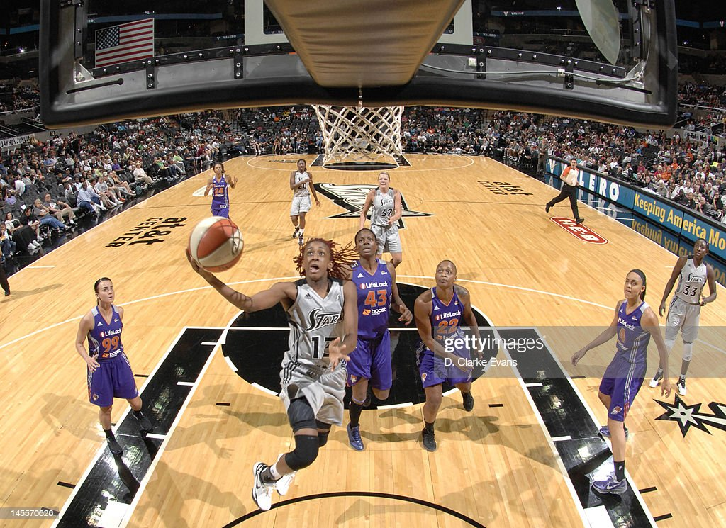 Danielle Robinson of the San Antonio Silver Stars shoots against Nakia Sanford and Charde Houston of the Phoenix Mercury at the ATT Center on June 1...