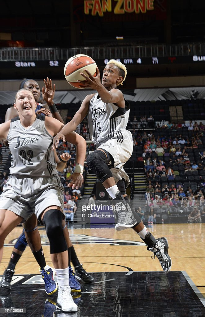 Danielle Robinson #13 of the San Antonio Silver Stars shoots against the Connecticut Sun at the AT&T Center on July 20, 2013 in San Antonio, Texas.