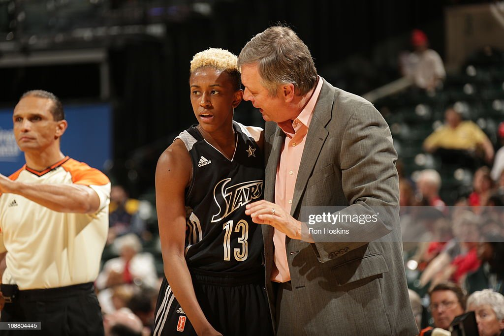Danielle Robinson #13 of the San Antonio Silver Stars speaks with head coach, Dan Hughes as the Silver Stars took on the Indiana Fever on May 13, 2013 at Bankers Life Fieldhouse in Indianapolis, Indiana.