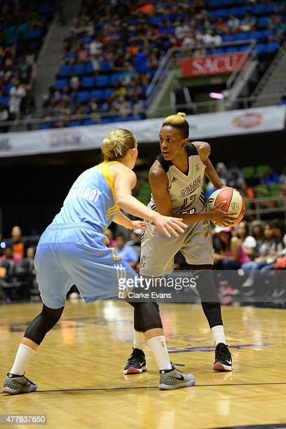 Danielle Robinson of the San Antonio Stars handles the ball against the Chicago Sky on June 20 2015 at Freeman Coliseum in San Antonio Texas NOTE TO...