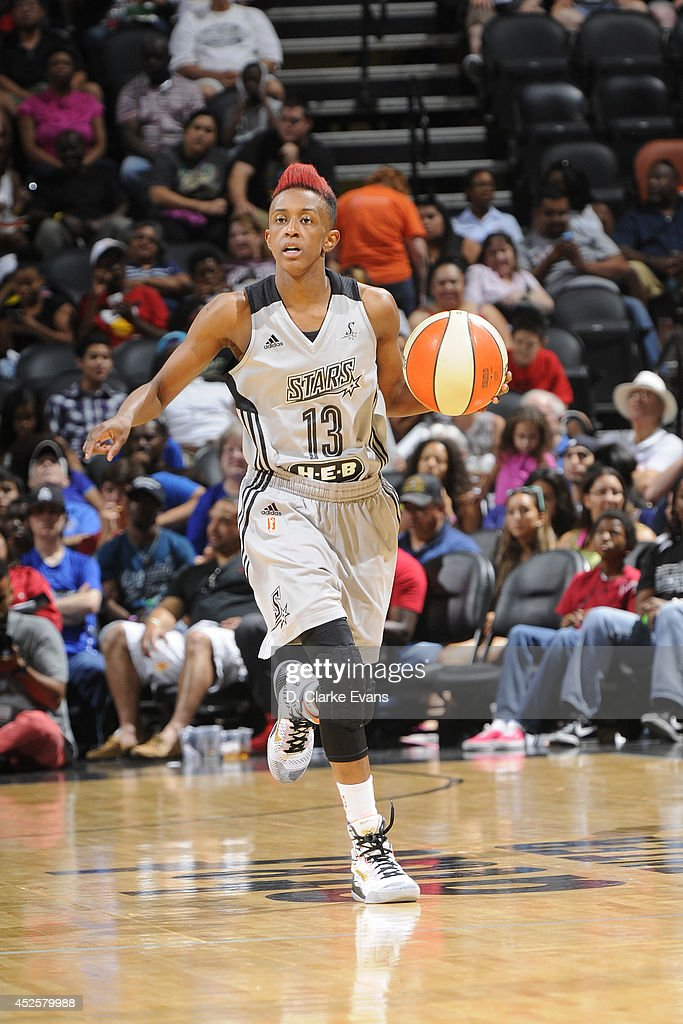 Danielle Robinson #13 of the San Antonio Stars moves the ball up-court against the Seattle Storm at the AT&T Center on July 11, 2014 in San Antonio, Texas.