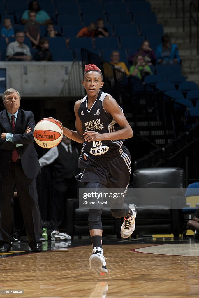 Danielle Robinson #13 of the San Antonio Stars moves the ball up-court against the Tulsa Shock during the WNBA game on July 17, 2014 at the BOK Center in Tulsa, Oklahoma.