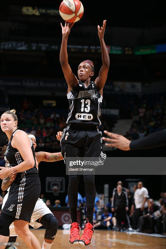 Danielle Robinson #13 of the San Antonio Stars shoots against the Minnesota Lynx on July 12, 2015 at Target Center in Minneapolis, Minnesota.