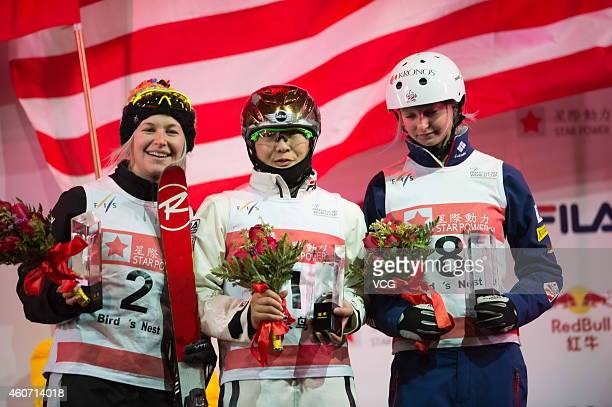 Danielle Scott of Australia in second place Xu Mengtao of China in first place and Kiley McKinnon of the United States in third place celebrate on...