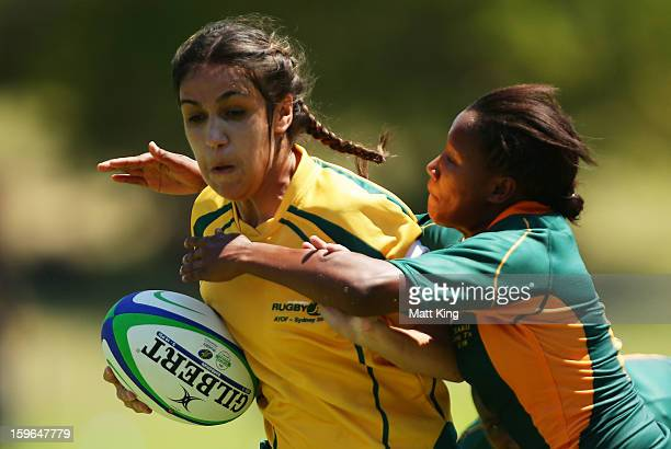 Danielle Smith of Australia charges towards the line to score a try in the Women's Rugby Sevens during day three of the Australian Youth Olympic...