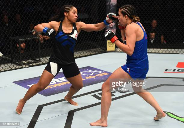 Danielle Taylor punches Jessica Penne in their women's strawweight bout during the UFC Fight Night event at Bridgestone Arena on April 22 2017 in...