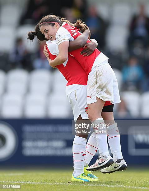 Danielle van de Donk of Arsenal celebrates after scoring their sixth goal and completing her hattrick with team mate Dan Carter during the SSE...