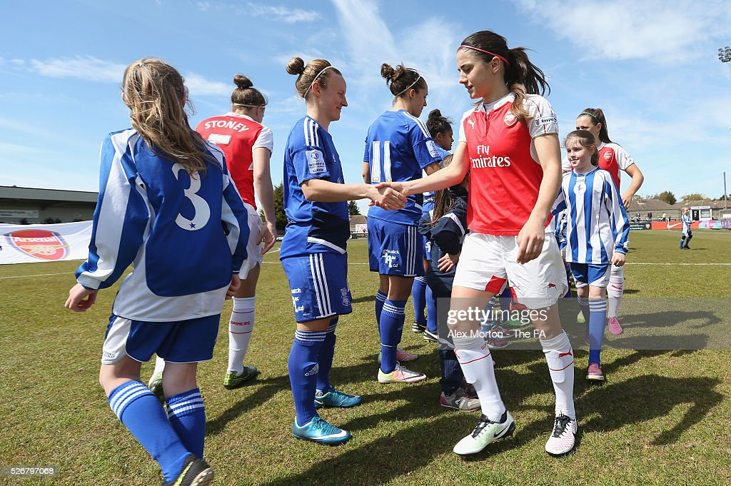 Danielle van de Donk of Arsenal shakes hands with Birmingham players prior to the WSL match between Arsenal Ladies and Birmingham City Ladies at Meadow Park on May 1, 2016 in Borehamwood, England.