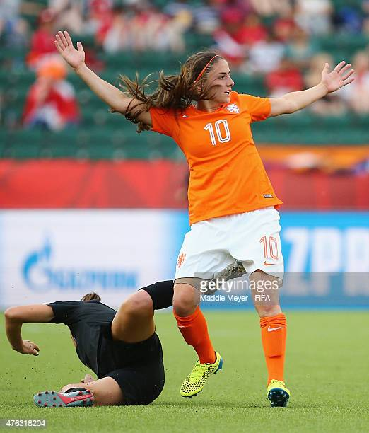 Danielle Van De Donk of Netherlands disputes a foul called against her during the FIFA Women's World Cup Canada 2015 Group A match between New...