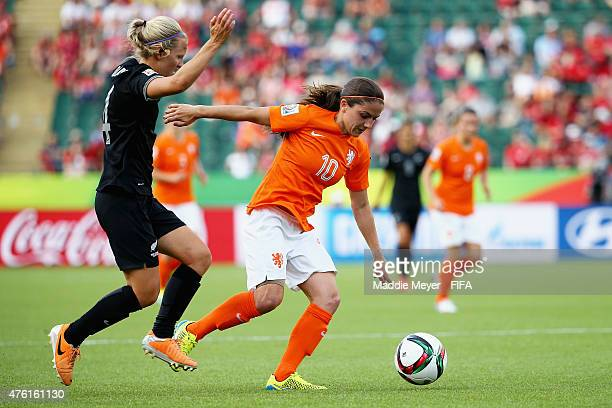 Danielle Van De Donk of Netherlands shields the ball from Katie Bowen of New Zealand during the FIFA Women's World Cup Canada 2015 Group A match...