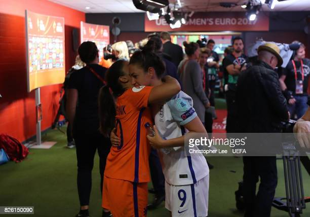 Danielle van de Donk of The Netherlands and Jodie Taylor of England embrace following the UEFA Women's Euro 2017 Semi Final match between Netherlands...