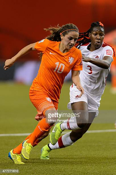 Danielle Van De Donk of the Netherlands and Kadeisha Buchanan of Canada run during the 2015 FIFA Women's World Cup Group A match at Olympic Stadium...