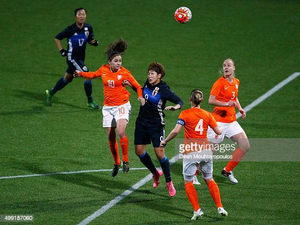 Danielle van de Donk of the Netherlands and Yuika Sugasawa of Japan challenge for the headed ball during the International Friendly match between...