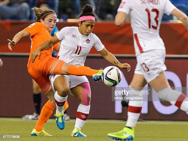 Danielle Van De Donk of the Netherlands battles for the ball with Desiree Scott of Canada during the 2015 FIFA Women's World Cup Group A match at...