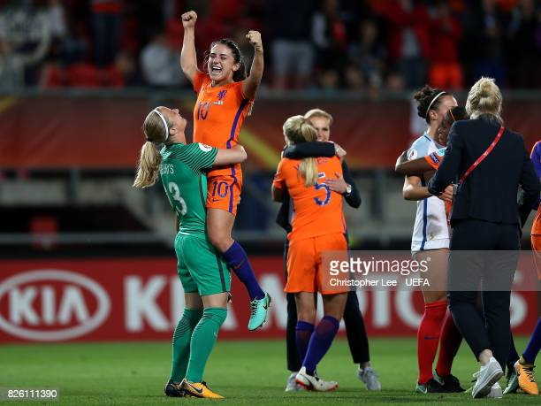 Danielle van de Donk of The Netherlands celebrates with team mate Loes Geurts after winning the UEFA Women's Euro 2017 Semi Final match between...