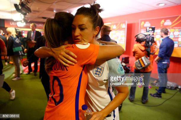 Danielle van de Donk of the Netherlands comforts Jodie Taylor of England after losing 03 the UEFA Women's Euro 2017 Second Semi Final match between...