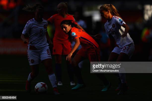 Danielle van de Donk of the Netherlands holds off pressure from Theresa Nielsen and Frederikke Thogersen of Denmark during the Final of the UEFA...