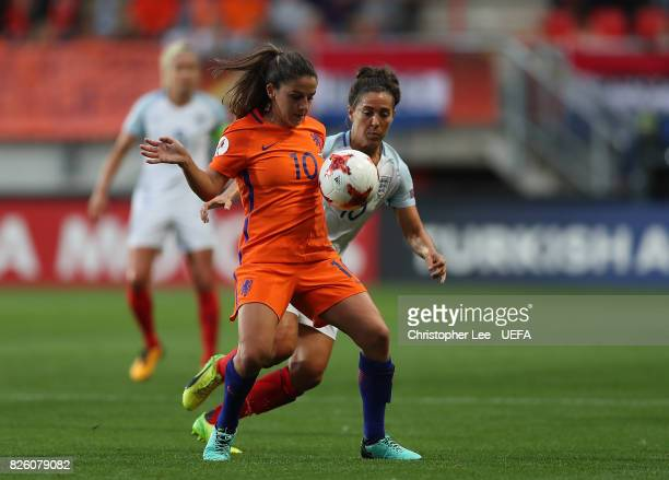Danielle van de Donk of The Netherlands holds off pressure from Fara Williams of England during the UEFA Women's Euro 2017 Semi Final match between...